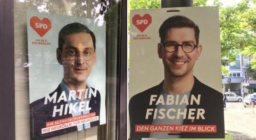 SPD-Wahlplakate mit den Porträts der Politiker Martin Hikel und Fabian Fischer unweit der Hermannstraße im Neuköllner Rollberg-Kiez